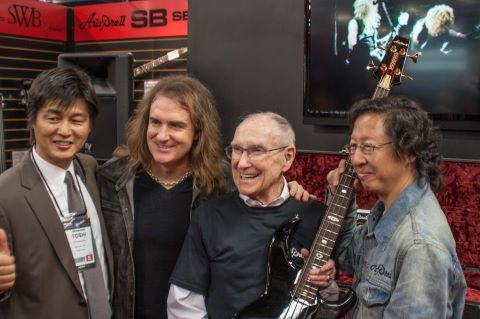 David Ellefson of Megadeth (2nd from left) and Ray Burton (2nd from right) at the ARIA Guitars booth at NAMM 2013. Photo credit: Metallica official Facebook.
